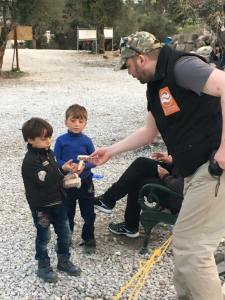 Mike handing out biscuits to the refugee children of Kara Tepe Refugee Camp