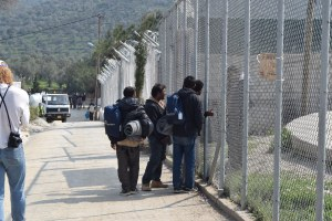 A handful of Pakistani refugee/migrants who at last minute feared going into the Moria Detention Centre talking through the fence to their friends that went inside.