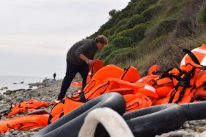 Volunteer clearing life jackets from one of the beaches on Lesvos