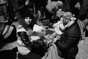 Myself and another volunteer caring for two little babies before we found their mothers after a boat load of refugees arrived in Lesvos from Turkey